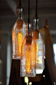 classy pendant lamps made out of old glass bottles most probably liquor bottles