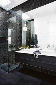 In the ensuite, black herringbone marble combine with sophisticated  results. Zuster double vanity from Reece is a standout.