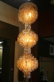 3 tier capiz shell chandelier 25000 via etsy capiz shell lighting fixtures