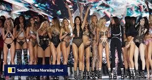 Chinese models Liu Wen and Ming Xi walk the runway at Victoria's ...