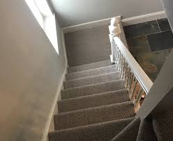 leave the sisal in position covering some of the wall and skirting boards to allow extra time for any shrinkage before returning to cut the edges and