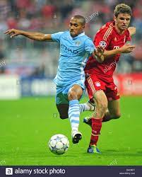 Munich's Thomas Müller (R) and Gael Clichy of Manchester City fight Stock  Photo - Alamy