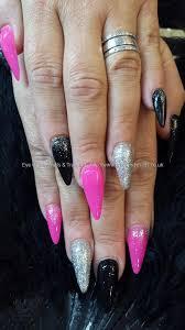 sti nails with pink black and silver nail art