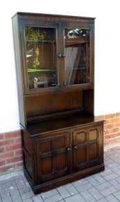 solid oak ercol old charm style bookcase with glass doors