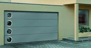stainless steel garage door with port hole windows