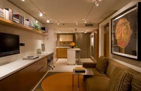 lighting for living rooms. Warm-and-relaxing-living-room-employs-track-lighting- Lighting For Living Rooms