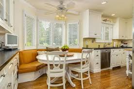 Traditional medium tone wood floor and brown floor kitchen/dining room  combo idea in Boston
