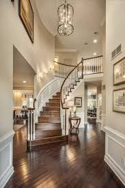traditional entryway with wainscoting high ceiling chandelier intended for designs 10