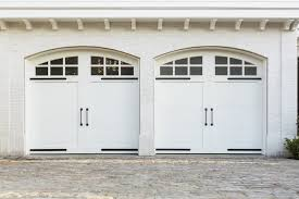 white wood garage door. This Bright White Brick Home Features Two Car Garage With Painted Wood Carriage Style Doors Door