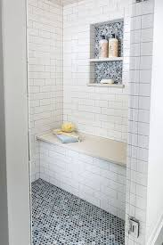 accent penny tile in a niche and on the floor in various blue patterns