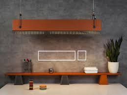 quattro pendant light burnt orange finish mdf grey metal grills and handles burnt orange wooden bench top white wall decorative accents concrete wall