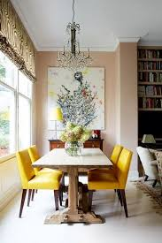 open plan dining and living room decorating ideas for small flats and studio apartments pink dining room with chandelier and yellow leather chairs