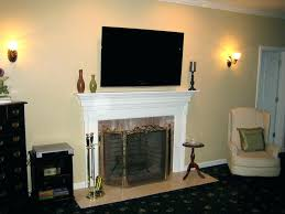 hang tv above fireplace where to put cable box install over hide wires ct wall wire