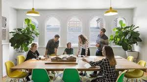 office design group. People Talk At A Large Conference Table Inside An Office Meeting Room. Walking Into MASS Design Group\u0027s Group