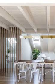 diffe chairs make a simple dining set more interesting 900x1350 this modern italian apartment is designed