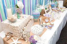 Back to the decoration, want something cute? Here is one idea, crepe paper  in blue shades and white or purple and you can do a cool backdrop in a  minute.