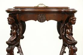 angel or cherub carved 1920 antique walnut coffee or chairside table glass tray