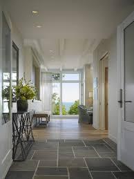 tile to hardwood transition gray stone tiles sliding glass door mid century modern cream bench white
