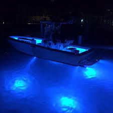 lumitec led rail lights mounted under the gunnels on center shadow caster lights up this center console boat 4 underwater lights in bimini blue and led deck lights