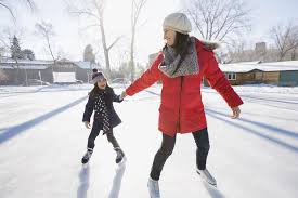 ice skating for tots and pre schoolers mother and daughter ice skating on rink