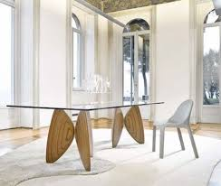 a modern table with a glass top and eye catchy wooden petal legs