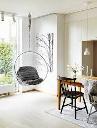 lovely hanging chair in a bright room with a garden view
