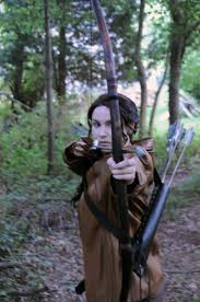 katniss everdeen hunting by moonflower lights on  katniss everdeen hunting by moonflower lights