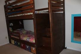 Bunkbed with bookshelves, stairs and storage bins