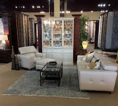 the ing team at nw rugs furniture merchandises furniture with rugs in vignettes in a variety of design styles