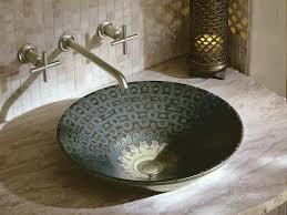 exotic bathroom sinks kohler serpentine bronze vessel sink in sandbar with purist wall mounted faucet