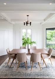 transitional dining room white walls dark pendant soft toned mid century modern dining chairs dark wood floors um toned wood dining table