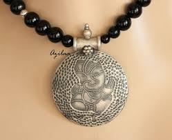 artisan ganesha medallion sterling silver pendant black onyx necklace
