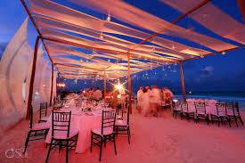 beach wedding reception set up dusk evening tables fabric pink lighting belmond maroma riviera maya