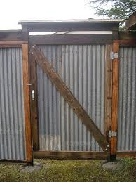 image of corrugated metal fence chain link custom privacy fence built out of metal post