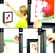 hanging frames on wall without nails wall hanging without nails hang how to hang paintings on