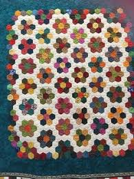 Sue Daley's Quatro Color Quilt displayed at Spring Quilt Market ... & Center of a hexie (EPP) quilt Adamdwight.com