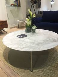 round coffee table with carrera marble on top