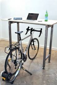 the kickstand desk ride your bike then stick it at your desk and keep peddling get exercise and someplace tho store your bike looks like it could be used bike office chair