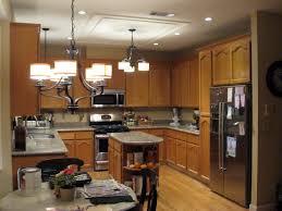 lighting flooring kitchen light fixture ideas glass countertops red oak wood black prestige door sink faucet island backsplash cut tile granite