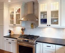 Kitchen countertop lighting Bottom Cabinet Kitchen With Glass Door Cabinets On Either Side Of Professional Stainless Range Hood With Under Cliqstudios Design Tip Choosing Undercabinet Light Fixtures