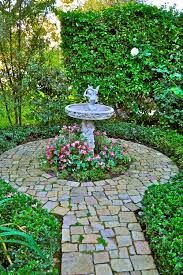 bird baths sometimes have little adornments attached some have birds while others have various animals