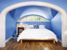 Lavish Blue Ceiling And Wall Painted With Large Master White Covers Bed On  Wooden Flooring As Well As Curved Glass Windows In Modern Blue Attic  Bedroom ...