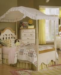 Kathy Ireland girls full size canopy bed bedroom set