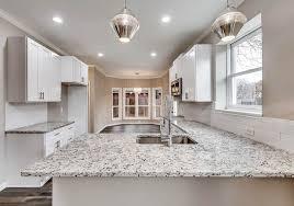 contemporary kitchen with dallas white granite countertops and white shaker cabinets