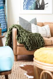 home has a tutorial for the most affordable of these projects at about 30 and she uses a yarn you can easily find at micheals her arm knit throw diy