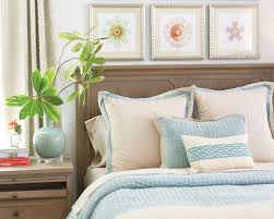 decorative toss pillows on the bed from ballard designs