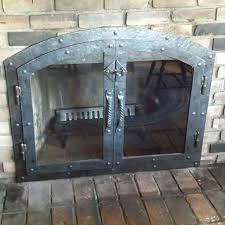 handmade custom hammered iron fireplace doors fireplace screen twisted handle by lazy k wrought iron custommade com