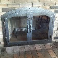 handmade custom hammered iron fireplace doors fireplace screen twisted handle by lazy k custommade com