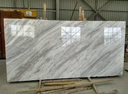 bookmatch greek white volakas marble slab flooring in 4 x 16 white stone subway tile backsplash