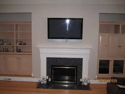 fireplace mount tv above fireplace no studs design and ideas over the without hearth what are